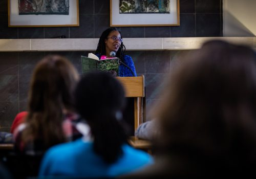 Author Camille Dungy reading at podium.